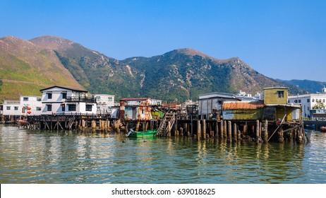 Old houses standing in the water in natural fishiing village Tai O, Lantau, Hong Kong