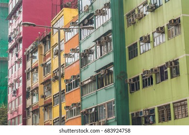 Old houses surrounded modern skyscrapers in Hong Kong. Hong Kong is popular tourist destination of Asia and leading financial centre of the world.