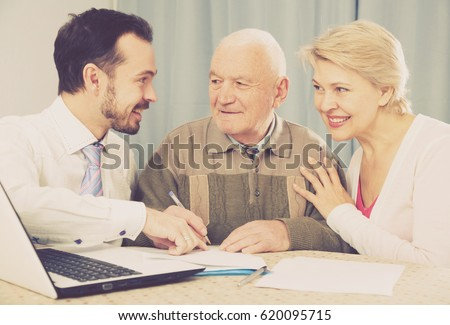 old husband wife signing agreement papers stock photo edit now