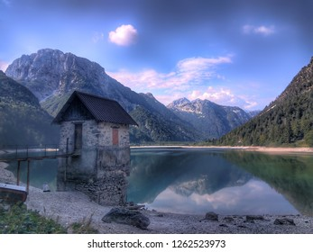 Old hut built on the coast of lago del Predil in Italy