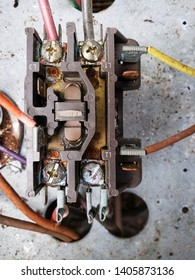 Old HVAC air conditioning condenser electrical components. Compressor, contactor and capacitor on an outdoor condensing unit.