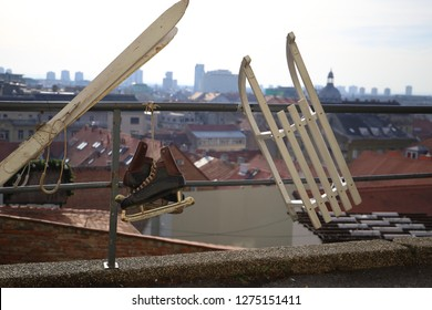 Old ice skates, skiis and sleigh suspended from a handrail as a winter decoration