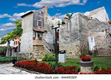 Old idyllic stone houses in Porec Croatia