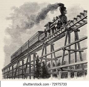 Alte Illustration des Zuges, der die hölzerne Treppenbrücke entlang der Unions-Pazifik-Eisenbahn überquert. Original, erstellt von Blanchard, wurde veröffentlicht auf L'Illustration, Journal Universel, Paris, 1868