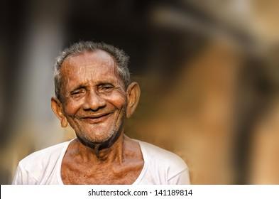 Old Indian Man portrait shot outside.