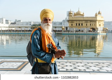 old indian sikh mans portrait in golden temple. 26 february 2018 Amritsar, India.