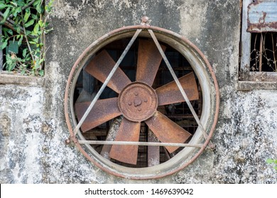 An old industrial fan that was left unused for decades.