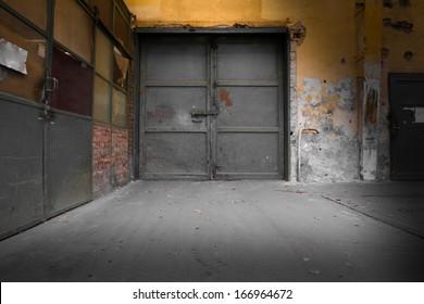 old industrial iron door, a machine factory