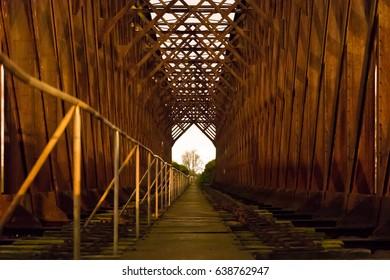Old industrial railway railroad iron bridge center perspective night