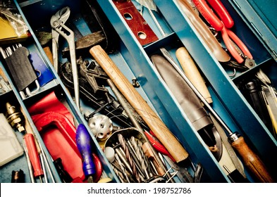 a lot of old instruments in tool box