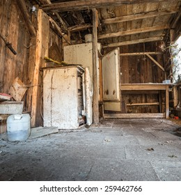 old interior of abandoned shed with fridges