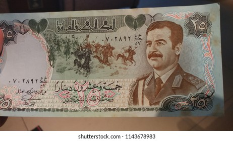Old Iraq dinar with Saddam's photo