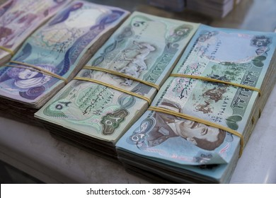 Old Iraqi money with the picture of Saddam Hussein on it used in 1980s in Iraq