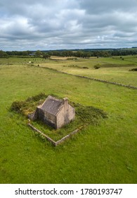 Old Irish farm cottage aerial view. Co. Roscommon, Ireland. July 2020