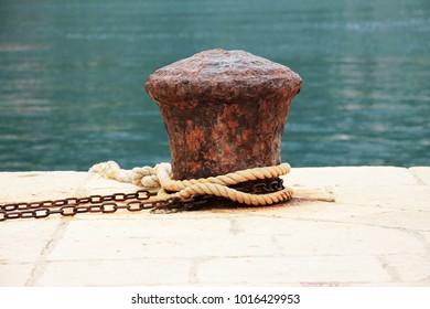 Old iron bollard near Adriatic sea , Croatia