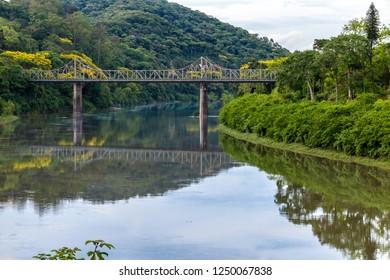 Old iron bridge and granite pillars on the Itajai-Açu river in Blumenal, Santa Catarina