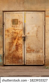 old iron door closed with a lock with an inscription in Russian -