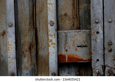 An old iron door that rusted. Selective focus