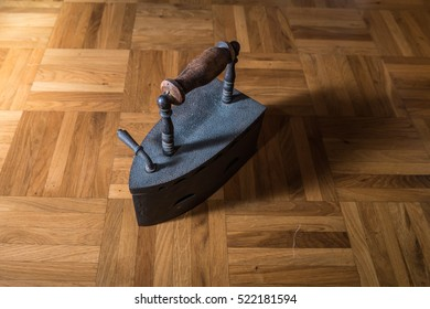 An old iron on a wooden floor
