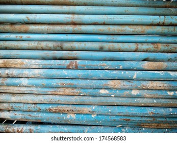 Old iron pipes stacked background