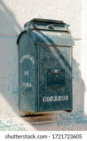 old iron postbox hanging on the wall