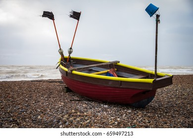 Old Isolated Fishing Boat on Pebbled Beach