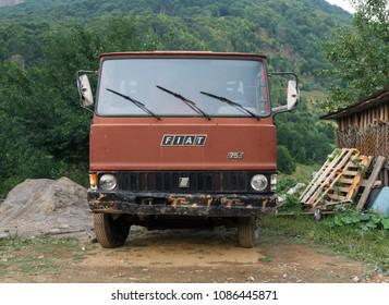 Old Italian Fiat Truck logo sign on a vintage rusty farm truck - Lepushe, Shkoder / Albania - August 2017