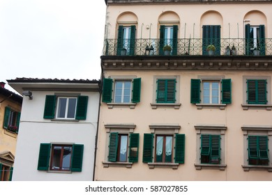 Old Italian house with green shutters and balconies and medieval architecture