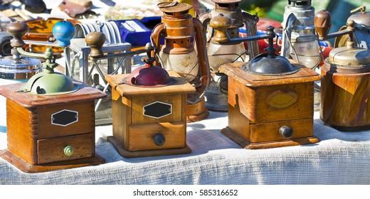 Old italian wooden coffee grinder exhibited in a street flea market (Italy)