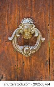Old italian wooden door with metal knocker