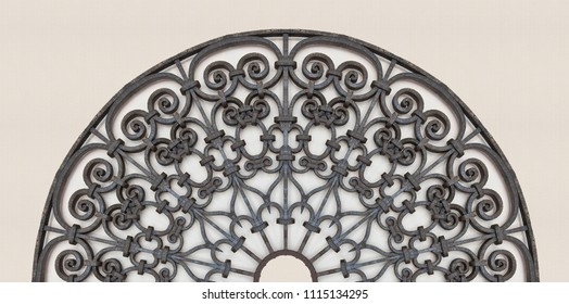 Old italian wrought iron grating with floral decorations