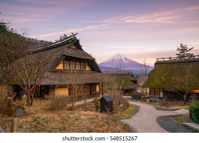 Old Japanese style house and Mt. Fuji  at sunset in Japan
