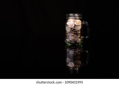 Old jar full of 90% silver US coins which no longer circulate.  The melt value for bu (silver) is much higher than the face amount on the coins.