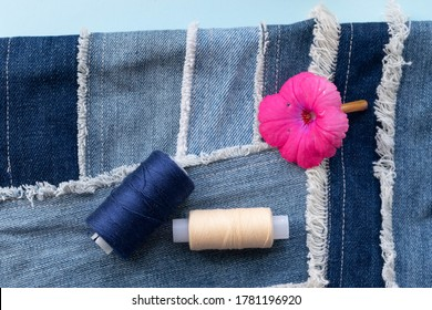 Old jeans ready to upcycling and pattern,  made from old jeans pieces. Concept of things reuse and natural resources preserving.