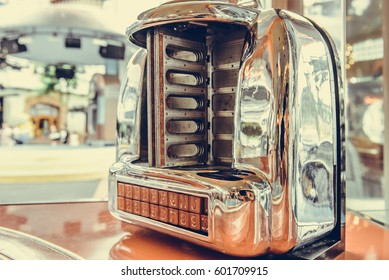 Old jukebox music player in Pub restaurant, Vintage style.