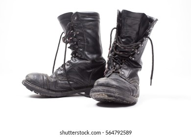 Old jungle leather boots on a white background