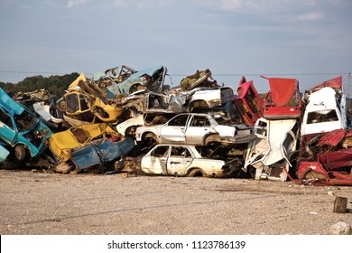 Old Junk Cars On Junkyard waiting for recycling
