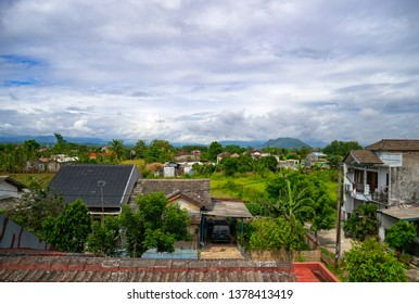 Old Kampong Village in Asia, with a beautiful  blue sky and very cloudy. This is typical kampong/village in Asia, especially Indonesia. Typical of Urban area but far away from the city center