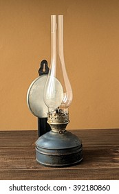 Old kerosene lamp on a brown background.