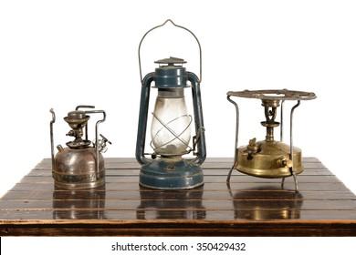 Old kerosene lantern, kerosene stove burner and gasoline. The equipment has withdrawn from use.