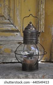 Old kerosene oil lamp on the wooden background