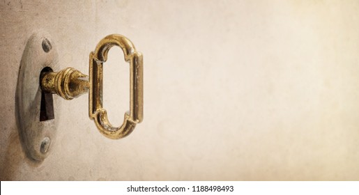 Old key in keyhole, macro shot. Retro style. Concept and Idea for History, business, security background. Write Your Text Here.