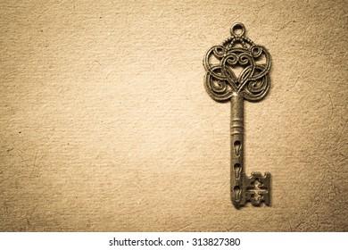 Old key on old paper