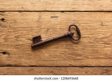 Old key on a wooden background