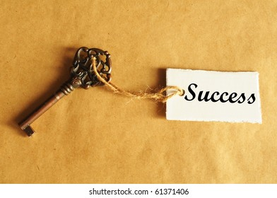 old key to success concept with label or tag