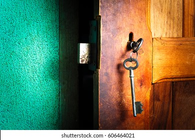 old keys on half open door. Security and safety concept