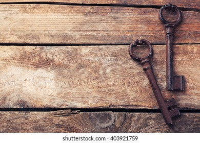 Old keys on wooden background, copy space