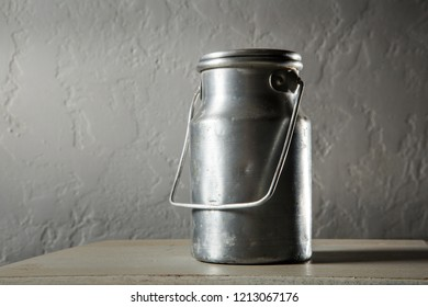 old kind of aluminum bidon for milk storage stands on kitchen table