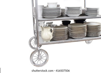 The old kitchen utensils on trolley isolated on the white background