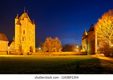 The old Kleve Gate (Klever Tor) in Xanten, Germany. Panoramic night shot with blue sky.